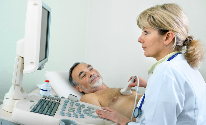 Male senior patient getting ultrasound from doctor